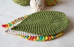 An easy leaf-shaped washcloth that makes a great quick gift. A good project for the beginner knitter who's ready to move beyond the square. Make them in leafy colors, or get zany with rainbow cotton. The finished size depends on what weight of yarn you choose.
