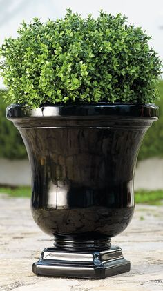 While clearly elegant, our Eileen Urn has a quite a secret: it's actually made of a fine crushed stone and resin composite, so it's lighter than cumbersome antique garden pots.