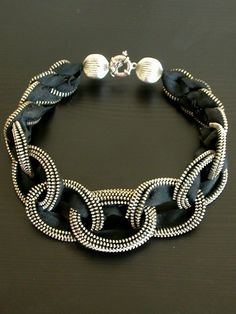 Length of necklace (including closure): 16-inch The necklace is created to have a chain mail design. There are different sizes of loop in the necklace, featuring the largest loop in the center, graduately descending to both side. The necklace is finished with two decorative large