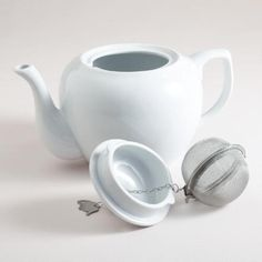 White Ceramic President Teapot - DETAILS & DIMENSIONS Crafted of porcelain Hand wash 40 oz. capacity