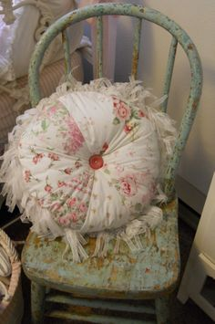 Shabby pillow on chippy green chair. Sewn by Kate Stern.