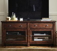 PB Benchwright TV Stand - switch out knobs for brass or take Jacie to Anthropologie and find some really cool ones.