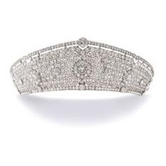 Property of a lady of title: CARTIER A MAGNIFICENT DIAMOND TIARA Of kokoshnik inspiration, articulated openwork design of millegrain quadrilobe motifs, set throughout with cushion-shaped diamonds, with larger stones in clusters at intervals, the mount hinged and sprung, mounted in platinum, ca. 1922, in a contemporary red Morocco case Signed Cartier, Paris Londres New York, numbered With a certificate of authenticity by Cartier