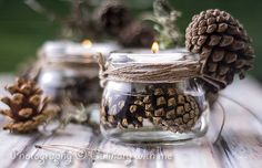 glass containers filled w/ pinecones & water.  Floating candle on top.
