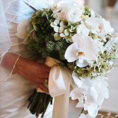 White orchid bridal bouquet.  Blooms by Martha Andrews-What an absolutely breathtaking bouquet!