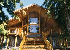 Incredible entry. Exterior shots of log homes from Traditional Log Homes - Modern ...