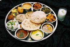 Gujarati cuisine is primarily vegetarian. The typical Gujarati thali consists of roti (rotlii in Gujarati), daal or kadhi, rice, sabzi/shaak, papad and chaas (buttermilk). Cooking Recipes In Urdu, Veg Recipes, Indian Food Recipes, Vegetarian Recipes, Ethnic Recipes, Vegetarian Restaurants, Gujarati Thali, Gujarati Cuisine, Gujarati Recipes