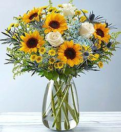 Premium Mixed Garden Bouquet Hand-tied artisan bouquet of yellow sunflowers, ivory roses, blue hydrangeas, cream solidago, yellow micro santini and erynigium