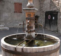 Ceillac ~  A wooden barrel-type fountain.