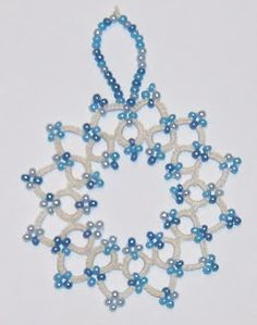 Tatted beaded snowflake What a difference a few beads make in a simple design!