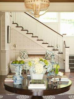 love a round table in a foyer - with a fabulous tile int he entry!!  and a great light fixture!!