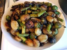 Crispy Gnocchi with Mushrooms, Asparagus, and Brussels Sprouts | One Green Planet (Saute in broth or water for oil-free option)