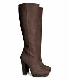 Knee-high Boots $59.95 DESCRIPTION Knee-high boots in imitation leather with perforated-pattern details. Side zip, small elasticized panel a...