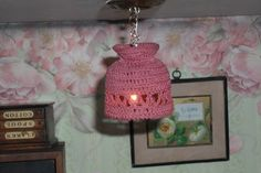 Lampshades can be made from all sorts of mini finds. This was a crocheted miniature basket, handle removed and hung upside down.