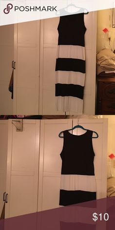NWOT. Never worn.  black and white maxi bodycon This dress is so sexy. Sadly I have too much and have never worn this. It is a large. It fits like a bodycon without the thick material. It is a poly/Lycra blend. Black to waist and striped to ankles. No Idea Dresses Maxi