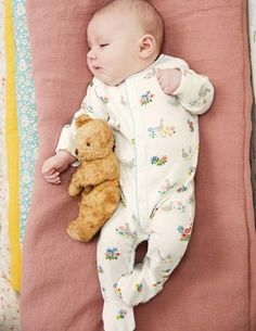 This 100% cotton jersey sleepsuit will keep little bundles comfortable all night long. With full sleeves and built-in feet, it makes the perfect bedtime outfit. And the two smallest sizes come complete with scratch mitts to protect delicate skin.