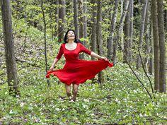 Viviane in Trillium Woods - Viviane wearing a red dress running in Trillium…