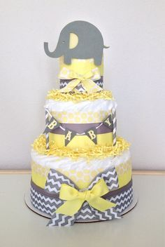 **PLEASE READ STORE ANNOUNCEMENT BEFORE PURCHASING** Lil Peanut Elephant Diaper Cake Colors: Chevron Gray, Yellow and White This