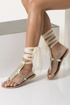Elpida sandals are handmade of genuine leather with a modern t-bar design and fasten with our signature silk laces. Make the color combination you prefer and wear them to ground everything from formal dresses to cropped blue jeans. Beach Wedding Sandals, Bridal Sandals, Ivory Sandals, Black Leather Sandals, Gold Leather, Leather Slippers, Bride Shoes, Casual Heels, Boho