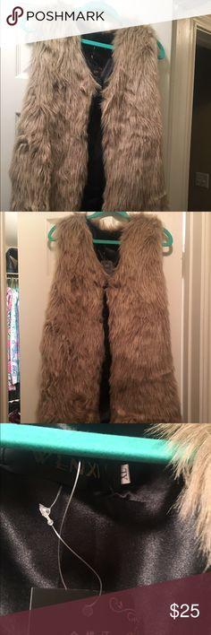 NWT Faux fur vest First picture is the vest directly under a light. Never worn. Good quality faux fur vest Jackets & Coats Vests