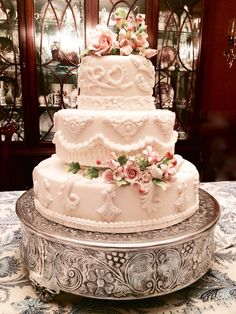 Vintage inspired wedding cake.  Three tiered wedding cake piped with Royal Icing, Gumpaste flower and Fondant cake.