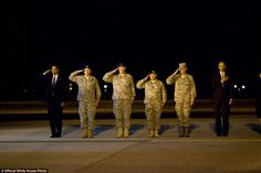 President Barack Obama, Eric Holder and US officers attends a ceremony at Dover Air Force Base in Dover, Delaware, October 29, 2009, for the dignified transfer of 18 U.S. personnel who died in Afghanistan