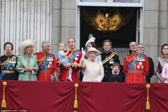 Queen Elizabeth waves from the balcony of Buckingham Palace during the Trooping of the Colour parade to mark her official birthday, alongside Prince George who delighted the adoring crowds waiting below
