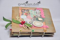 Brown paper bag mini-album using PPS May cardmaking kit  http://scrappydonna.blogspot.com/2012/05/pretty-paper-studio-may-kits-reveal.html