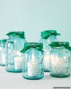 mason jar candle holders....like this but with purple/silver/black ribbons