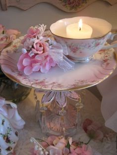 A pretty plate and an ornate candlestick make a lovely pedestal cake plate. When not being used for dessert, it makes a charming display with a matching teacup,  tealight candle, and posie of flowers.