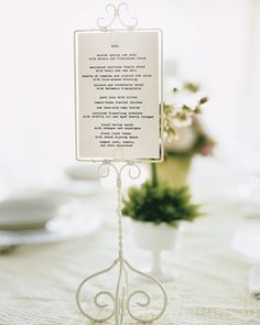 Menu cards displayed in footed, wired picture frames add to reception table decor.