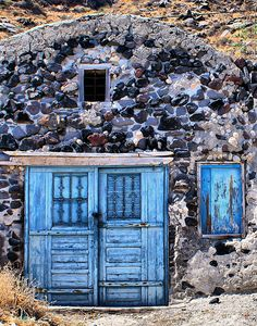 Santorini, Greece - TARDIS prototype. Needed to be smaller on the outside. Actually contains a football stadium.