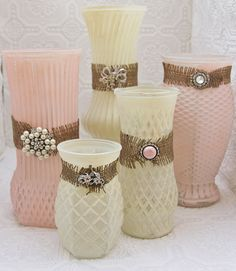 Painted vases with burlap and jewelry adornments