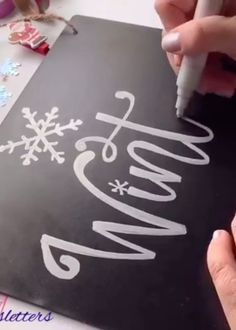 Celebrating winter with silver chalk lettering on chalkboard paper. Smooth writing that is so satisfying to watch. Chalkboard Writing, Chalkboard Lettering, Chalkboard Designs, Chalkboard Paper, Chalkboard Art Tutorial, Christmas Chalkboard Art, Chalk Writing, Chalkboard Drawings, Hand Lettering Art