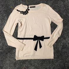 The limited bow sweater Worn once, light pink with black bow design, lighter sweater, super comfy and soft, open to reasonable offers, no trades The Limited Sweaters