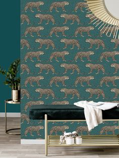 This stunning Leopard Wallpaper would make a unique and stylish feature in your home. The design features a repeat pattern of beautifully detailed leopards in metallic gold, set on a leopard print patterned background in tones of emerald green. Easy to apply, this high quality wallpaper has a beautiful metallic sheen finish and will look great when used to decorate a whole room or to create a feature wall. This colourway is exclusive to World of Wallpaper and can not be found on the high street. Emerald Green, Green And Gold, Blue Gold, Metallic Gold, Leopard Wallpaper, Animal Print Wallpaper, Paper Wallpaper, High Quality Wallpapers, Stuffed Animal Patterns