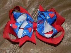 Red/White/Bright Blue- PEACE AND HEARTS stacked bow  You choose clip type or put it on a woven headband- can be made in ANY size  $7.00 ©2011Hairbows*N*More Find me on Facebook! Hairbows N More