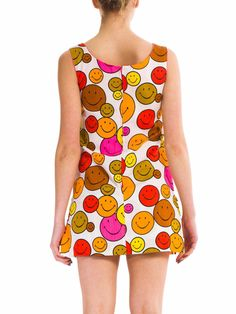 - Product Description - Measurements DETAILS This is the happiest little dress on Earth! The vibrant red, orange, yellow and pink smiley faces pop off the white background. The shape is classic 60's m
