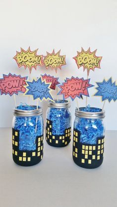 Boom! Pow! Zap! These Superhero party table centerpieces are going to be a show stopper at your next party. They are perfect for a boy birthday party or baby shower! This purchase includes a set of three (3) centerpieces exactly as shown. The jars used measure 6 inches tall and 4 inches wide. Each jar is hand painted, filled with blue crinkle filler and each jar has 3 centerpiece sticks that read Boom Zap and Pow that are made with heavy multi-layered card stock. Please note that the…
