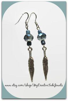 Beautiful blue boho feather earrings.  SHOP: https://www.etsy.com/shop/MyCreativeSideJewels