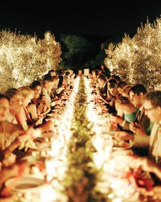 How magical does this tablescape look, completed with twinkling lights on the trees? For this wedding in Greece, the planner, The Genie, placed the dining tables between olive trees.