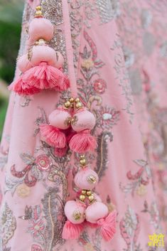 The ultimate list of gorgeous Lehenga and Blouse Latkan designs that are ruling the internet. From tassels to pom-pom designs, choose not just one but more. Pink Lehenga, Bridal Lehenga, Saree Tassels Designs, Passementerie, Indian Designer Wear, Blouse Designs, Making Ideas, Embroidery Designs, Churidar