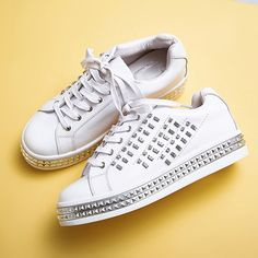 Chiko Harriet Studded Fashion Sneakers feature round toe, lace up front, studded upper, pyramid rivet decorated sneaker rubber…