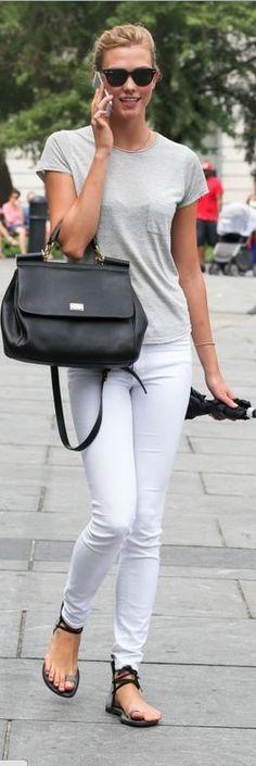 Who made Karlie Kloss' black leather handbag and white skinny jeans