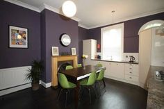 Large spaces are make interesting and intimate with deep aubergine walls and dark floors in Leeds