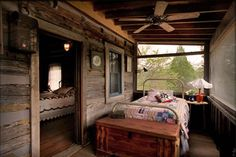 Reminds me of my years as a camp counselor.  Iron bed, screened porch on a cabin!!