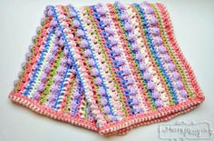 The Candy Crush Baby Blanket -- uses a variety of crochet stitches to create a unique texture that is fun and playful. Practice your bobble stitch, cluster v-stitch, pucker stitch, mesh stitch and more with this one-of-a-kind crochet baby blanket.  Free crochet pattern.  Read more at http://www.allfreecrochetafghanpatterns.com/Baby-Blanket-Afghans/Candy-Crush-Baby-Blanket#iOhRhMBrRj76kjM7.99