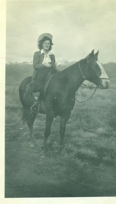 Cowgirl Woman Riding A Horse Rocky Mountain West Cowboy Hat Horseback Vintage Black and White Photo Photograph..