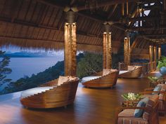The lobby of @Four Seasons Resort Koh Samui, Thailand offers an open-air vista of the valley below.