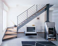 #Escalier - Quart tournant, limons latéraux, matches en bois, structure en acier. Découvrez les réalisations d'escaliers de L'Échelle Européenne sur www.escaliers-echelle-europeenne.com